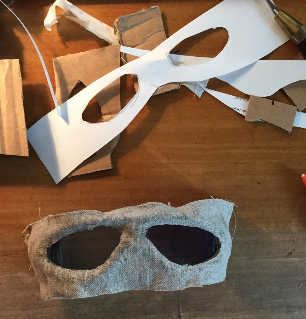Gluing linen to goggles.