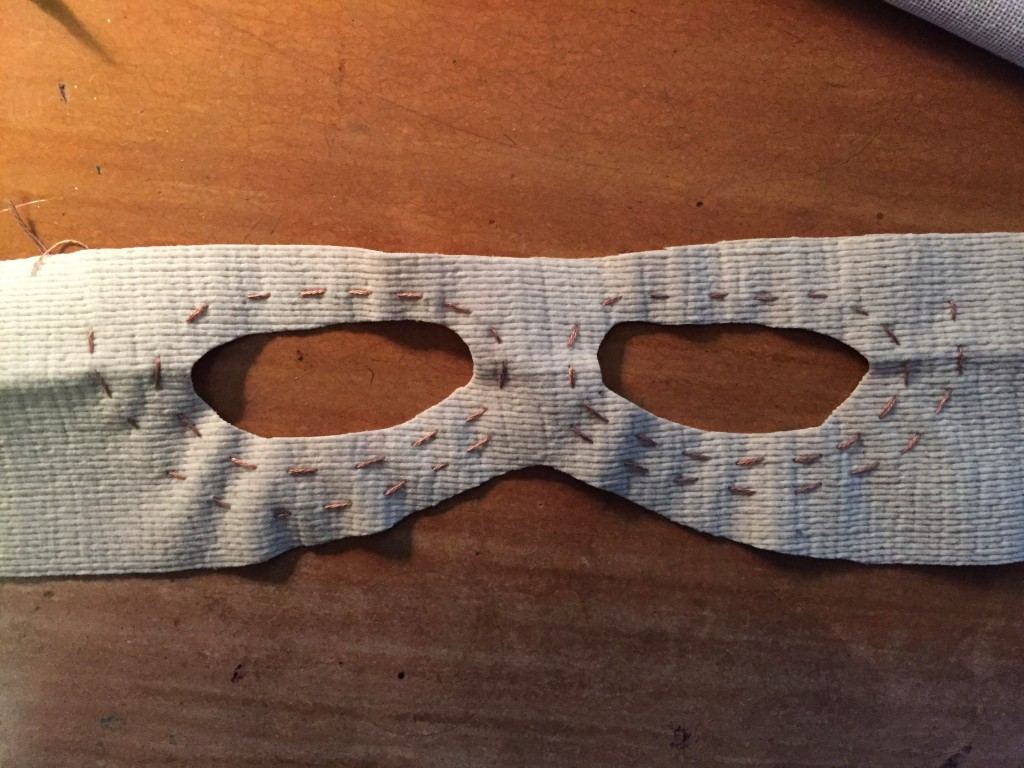 After sewing stitch detail around eye holes